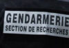 Inscription au dos d'un gendarme : Gendarmerie - Section de recherches