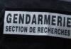 Inscription au dos d'un gendarme : Gendarmerie - Section de recherches